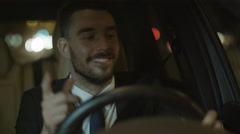 Happy Smiling Businessman Driving a Car at Evening Arkistovideo