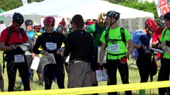 Athlete people analyse challenge maps before orienteering course start. Stock Footage