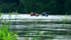 People in pair canoe active recreate on wild water river in nature. Stock Footage