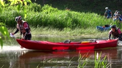 Active sportsman push canoe through wild water river. Stock Footage