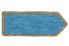 Arrow made of denim with yellow rhinestones, isolated Stock Photos