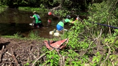 Competition participants with life jackets floating on finfoam in swamp water. Stock Footage
