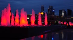 MOSCOW, RUSSIA - SEPTEMBER, 10. Red LED lit Moscow Victory park fountains at Stock Footage