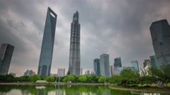 Storm shanghai downtown buildings park pond panorama 4k time lapse china Stock Footage