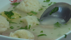 Hungry person eat delicious chicken soup spoon dinner dish main course aromatic  Stock Footage