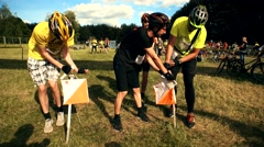Exhausted athletes people at orienteering sport competition finish. Stock Footage