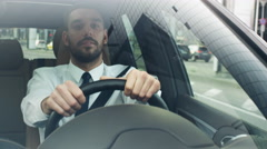 Businessman Driving a Car in Business District, Checking the Time. Stock Footage