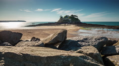 Sunset ocean bay island castle low tide panorama 4k time lapse france Stock Footage