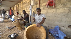 Traditional African drum maker - wood carving artist in Africa Stock Footage