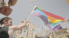 Jewish Man in yarmulke / kippah with rainbow flag, Tel Aviv, Israel Stock Footage