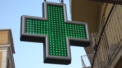 Sign pharmacies in the form of a large cross with lights Stock Footage