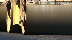 Vibratory roller rolls hot asphalt Stock Footage
