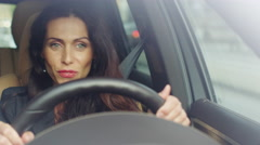 Excited Attractive Business Woman Listening to Music While Driving a Car. Stock Footage
