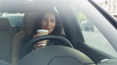 Attractive Smiling Business Woman Driving a Car early in the Morning. Stock Footage
