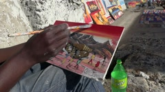 South African street artist paints township and mountain scene Stock Footage