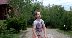 Little Girl With Racket and Shuttlecock Playing Badminton and Having Fun Stock Footage