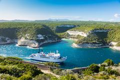 Ferry boat entering Bonifacio port, Corsica island, France Stock Photos