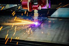 CNC Laser plasma cutting of metal, modern industrial technology. . Kuvituskuvat