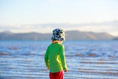 Cute Little girl walking on Coromandel beach, New Zealand. Stock Photos