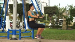 Young athlete woman is doing some sport exercises to push-off in the street Stock Footage