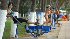 Young athlete woman is doing some sport exercises on rowing machine in the Stock Footage