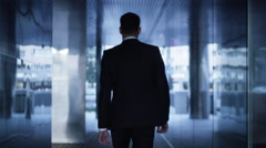 Businessman Walking on Streets of Business District outwards Camera Stock Footage