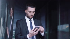 Businessman Using Mobile Phone Outdoors Stock Footage