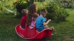 Children Blow Bubbles in the Garden Stock Footage
