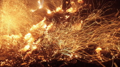 Many Fire Sparks Rising up From Bonfire Smoldering Dry Tree Leaves Stock Footage