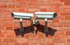 Surveillance cameras mounted on the wall of the building Stock Photos