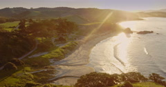 Aerial over beach and calm ocean at Tawharanui, auckland Stock Footage