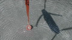 POV from a water dropping helicopter of the bucket. Stock Footage
