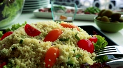 Big table with various meals in the restaurant - detail of Couscous -other meals Stock Footage