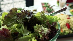 Detail of salad on the table - other meals (Couscous) in background Stock Footage