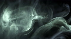 The stream of thick smoke on a dark background. Slow motion capture Stock Footage