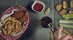 4k Traditional Irish Fish and Chips with Guinness, Opening Bottle Stock Footage
