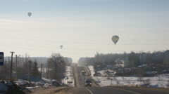 Image of hot air balloons flying over city Stock Footage