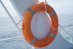 Life buoy attached to the cruise ship Stock Photos