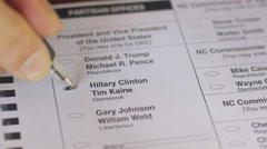 Close up of a ballot voting for Hillary Clinton and Tim Kaine Stock Footage