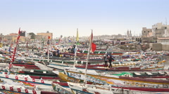Fishing boats on the Senegal river, poor cityscape - Saint Louis, Africa Stock Footage