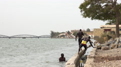 African black men swimming in the Senegal river - Saint Louis, Africa Stock Footage