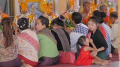 Kid is bored while mother prays in temple,Vientiane,Laos Stock Footage