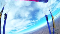 Skydiver parachuting in cloudy grey sky. Extreme. Adrenaline. Above arizona Stock Footage