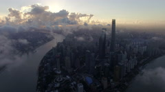 Bird view of the busy city in the sky over Pudong CBD at sunset,Shanghai, China Stock Footage