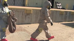 A radiation team responds to an emergency during this drill. Stock Footage