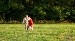 Early Autumn Man on the Field Helps Keep Drunk Santa Stock Footage