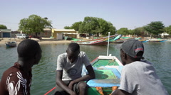 African fishermen cruising by boat - Senegal Stock Footage
