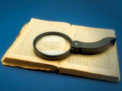 Magnifier at the Book Stock Photos