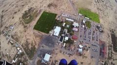 Skydiver parachuting in sky. Extreme sport. Adrenaline. Above arizona. Landing Stock Footage