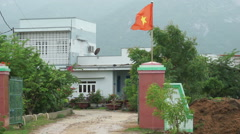 National flag of Vietnam is fluttering on an entrance to local's house in Stock Footage